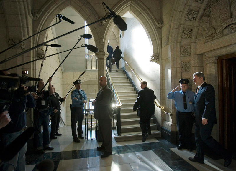 With cameras and microphones pointed his way Prime Minister Stephen Harper (right) leaves the House of Commons after Question Period, Tuesday February 27 2007.(CP PHOTO/Fred Chartrand) Canada