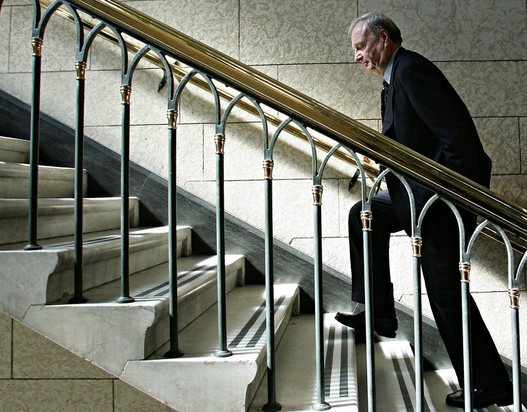 Prime Minister Paul Martin makes his way up the stairs to his office on Parliament Hill, after a raucous Question Period in the House of Commons in Ottawa, on Monday April 11, 2005. (CP PHOTO/Fred Chartrand)