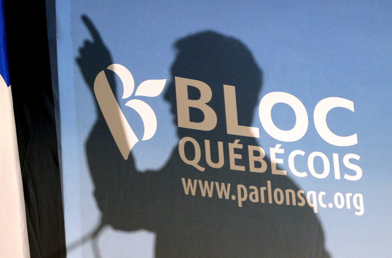 Bloc Quebecois Leader Gilles Duceppe casts a shadow on a campaign backdrop as he speaks to a crowd of students at a CEGP de l'Outaouais in Gatineau, Quebec, Thursday April 14, 2011. THE CANADIAN PRESS/Fred Chartrand