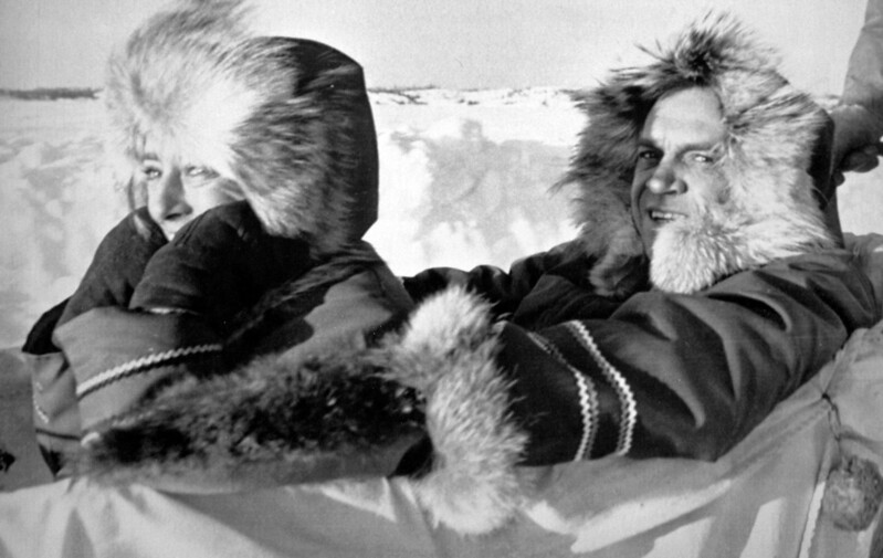 Then NDP leader Ed Broadbent (right) and his wife Lucille cut through the cold wind in Yellowknife, N.W.T. in this Jan. 21, 1980 while canpaigning. (CP PHOTO/Fred Chartrand)