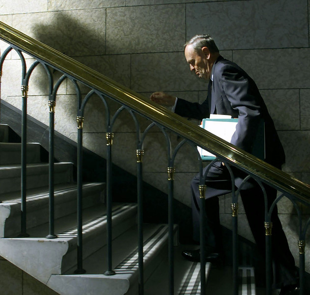 Prime Minister Jean Chretien makes a dash up to his office after Question Period in the House of Common on Wednesday September 19, 2001. (CP PHOTO/Fred Chartrand)