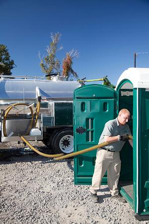 teddy bammann pumping out a toilet