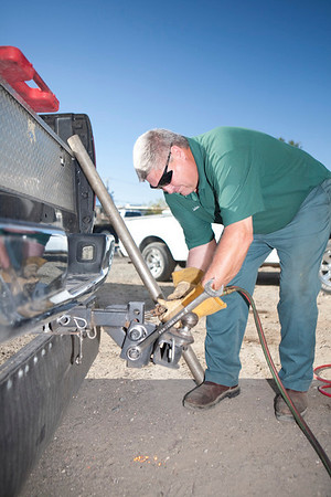 john mixon welding a tow hitch at natures calling headquarters