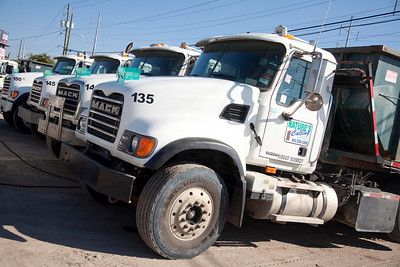 fleet of trucks at natures calling headquaters