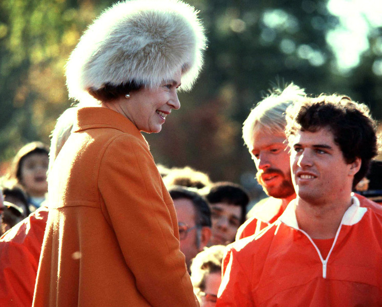 Queen Elizabeth II talks with Canadian rowers at Ottawa's Dow Lake where she went to watch the Silver Jubilee Regatta, Oct. 15, 1977. (CP PHOTO/Fred Chartrand)