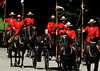 Japanese Emperor Akihito arrives by horse drawn landau with RCMP outriders during an official welcoming ceremony at Rideau Hall the official residence of the Governor General of Canada in Ottawa, Canada, July 6, 2009.(left). (Fred Chartrand)