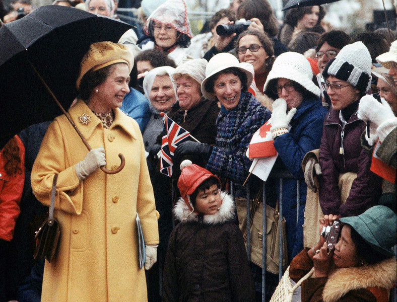 Queen Elizabeth II smiles as a spectator takes a photograph of her on Paeliament Hill, Oct. 16, 1977. (CP Photo/Fred Chartrand)