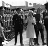 Escorted by Chief of Defence Staff Admiral Falls (left) Queen Elizabeth II inspects the College Royale Militaire guard of honor at Ottawa airport before leaving for the Bahamas, Oct. 19, 1977. The college is in St. Jean, Que. (CP PHOTO/Fred Chartrand)