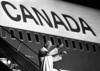 Pope John Paul II waves to the crowd at the Ottawa airport as he prepares to return to Rome, Sept. 20, 1984. (CP PHOTO/Fred Chartrand)