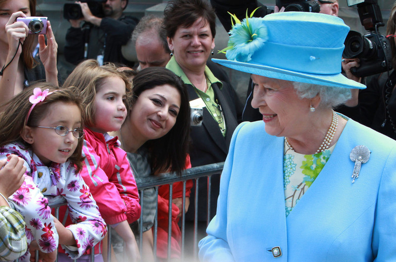 Queen Elizabeth walks by well-wishers after she visits the Canadian Museum of Nature in Ottawa, Wednesday June 30,2010.THE CANADIAN PRESS/Fred Chartrand