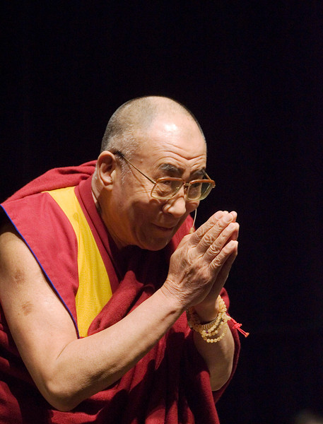 The Dalai Lama gestures during a speech to an arena filled with wellwishers in Ottawa, Sunday,  October 28,  2007. The Dalai Lama is on a three-day visit to the Canadian capital. THE CANADIAN PRESS/Fred Chartrand