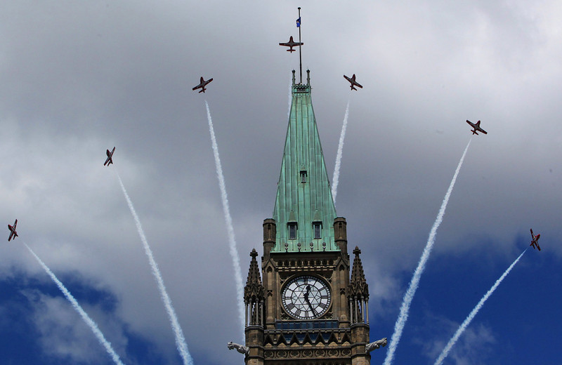 Canadian Snowbirds fly over top of the Peace Tower during Canada Day celebrations with The Duke and Duchess of Cambridge in Ottawa on Friday, July 1, 2011. THE CANADIAN PRESS/Fred Chartrand