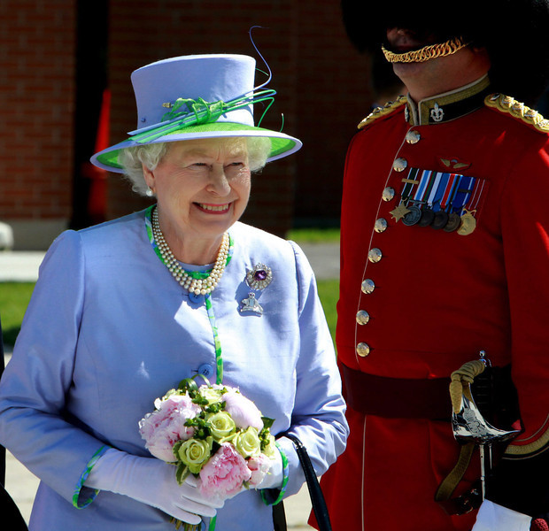 The Queen smiles as she prepares to leave the Ottawa Airport enroute to Winnipeg, Manitoba on Saturday July 3, 2010. THE CANADIAN PRESS/Fred Chartrand
