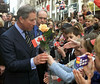 Prince Charles is handed a tulip from children during a walkabout on the Sparks St. Mall after his arrival in Ottawa, Wednesday, April 25, 2001.(CP PHOTO/Fred Chartrand)