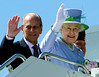 The Queen and the Duke of Edinburgh wave has they depart by aircraft from the Ottawa Airport enroute to Winnipeg, Manitoba on Saturday July 3, 2010. THE CANADIAN PRESS/Fred Chartrand
