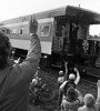 Residents of Cardinal, ON., wave to Queen Elizabeth II and Prince Philip as the Royal Train takes them through eastern Ontario Sept. 27, 1984, during their visit to Canada. (CP PHOTO/Fred Chartrand)