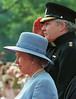 (OTT106)Ottawa, June 30--HONORARY COLONEL--The Queen listens to the national anthem while Conrad Black, Honorary Colonel of the Governor General's Foot Guards, salutes during a ceremony at Government House in Ottawa Monday.(CP      PHOTO)1997(stf-Fred Chartrand)fxc