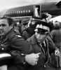 RCMP security men lock arms to prevent photographers from getting too close to Pope John Paul II in Yellowknife, N.W.T., Sept. 18, 1984. The Pope, waving from the plane's ramp, made an unschduled stop after fog prevented him from visiting Fort Simpson.   Fred Chartrand/The Canadian Press