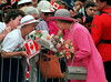 Queen Elizabeth II greets some of the approximately 40 thousand flag waving Canada Day revellers on Parliament Hill in Ottawa July 1, 1992. The Queen joined the crowd to help celebrate Canada's 125th birthday. (CP PHOTO/ Fred Chartrand)