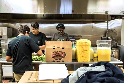 A team of Sac High graduates, including (from left) Angel Roque, Leo Lopez and Christian Jackson, work in the production kitchen at Preservation & Co. to bottle the pineapple-jalapeno flavor of Sangre del Dragon hot sauce.