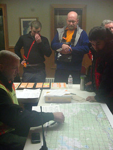 Search and Rescue volunteers listen to a midnight briefing before heading out looking for a missing person near Donner Pass.