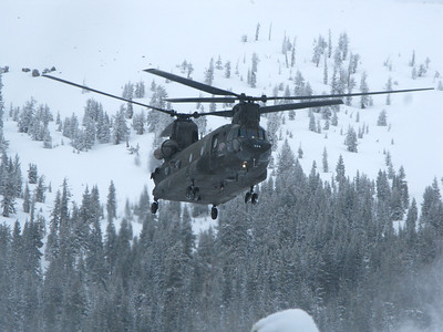 A military Chinook twin rotor helicopter assists in the search for the missing person.