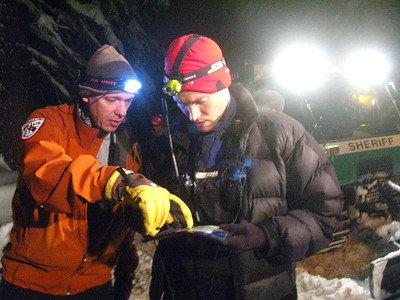 Mountain Rescue searchers determine the best route to their search assignment.