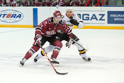 Pyotr Schastlivy (24) tries to protect the puck from Denis Yezhov (82) in the KHL regular championship game between Dinamo Riga and Severstal Cherepovets, played on January 3, 2017 in Arena Riga