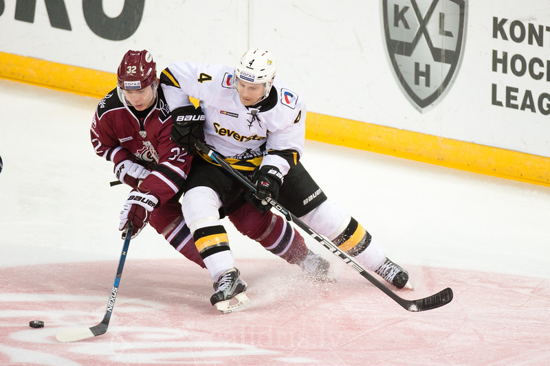 Clay Wilson (4) of Severstal Cherepovets tries to stop Edgars Kulda (32) in the KHL regular championship game between Dinamo Riga and Severstal Cherepovets, played on January 3, 2017 in Arena Riga