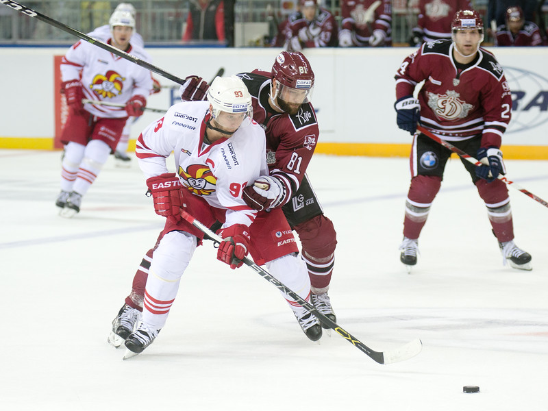 Colton Gillies (81) of Dinamo Riga tries to stop Peter Regin (93) in the KHL regular championship game between Dinamo Riga and Jokerit, played on September 13, 2016 in Arena Riga