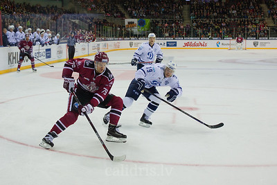 Denis Kokarev (19) tries to stop Vitalijs Pavlovs (79) in the KHL regular championship game between Dinamo Riga and Dynamo Moscow, played on October 3, 2016 in Arena Riga
