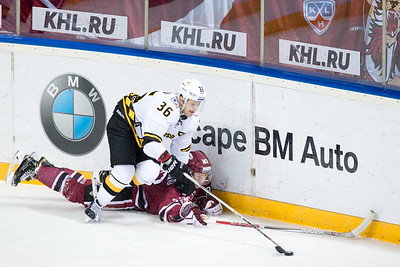 Anton Sizov (36) pins down on ice Georgs Golovkovs (83) of Dinamo Riga in the KHL regular championship game between Dinamo Riga and Severstal Cherepovets, played on January 3, 2017 in Arena Riga