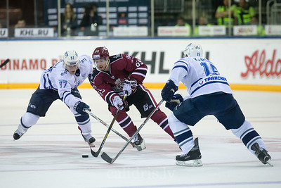 Maxim Karpov (97) and Martins Karsums (15) trie to stop Nikolajs Jelisejevs (69) in the KHL regular championship game between Dinamo Riga and Dynamo Moscow, played on October 3, 2016 in Arena Riga
