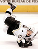 CRECROPPED VERSION OF OTTF106 -- Pittsburgh Penguin Sidney Crosby winches as he flies through the air on a hit by Ottawa Senators Andrej Meszaros (14) from Povazka Bystrica, Slovakia during third period NHL hockey in Ottawa, Tuesday March 21, 2006.(CP PHOTO/Fred Chartrand)