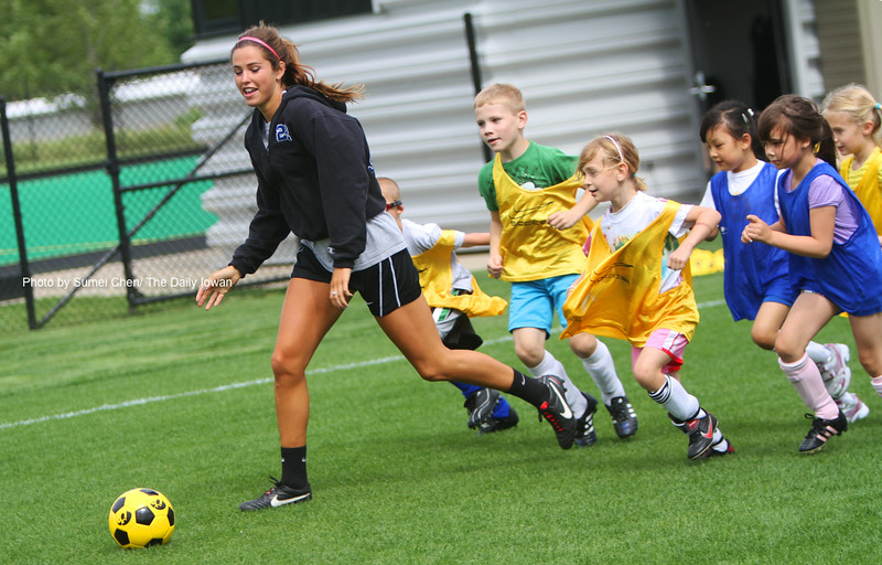Iowa City, Iowa-  UI Sophomore Leah DeMoss plays soccer with young children in the Iowa Soccer Complex on Monday, June 4, 2012. Children aged from 5 to 18 participate in the Hawkeye Summer Soccer Camps. (The Daily Iowan/Sumei Chen)