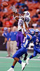 Newton High School split end Meredith Diggles (20), left, goes up for a pass under coverage from Royal High School defensive back DJ Emerson (10) Saturday afternoon near the end of the first quarter of playoff action in the Houston Astrodome. The pass was incomplete.<br /> PHOTO/SCOTT ESLINGER                   DEC 4, 2004