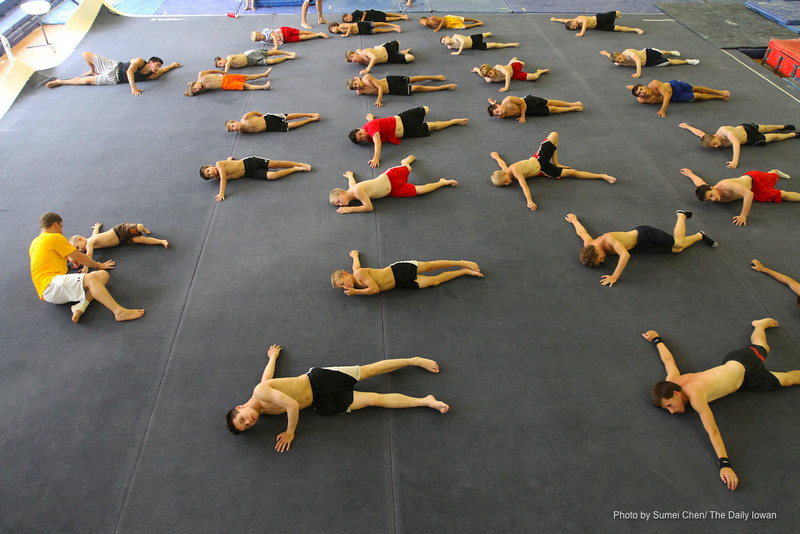 Iowa City, IA- Campers stretch out during Iowa Boy's Gymnastics Camp in Field House on Monday, July 9, 2012.(The Daily Iowan/Sumei Chen)