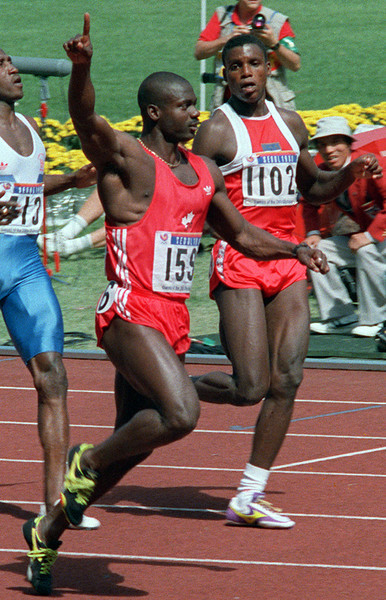 HiRes--Canadian sprinter Ben Johnson raises his hand in victory as  American Carl Lewis comes in second in the one hundred metre final race Sept. 24, 1988 at the Seoul Olympics.  Johnson subsequently tested positive for the banned steriod stanozolol and was stripped of his gold medal. (CP PHOTO) 1996 (Stf-Fred Chartrand)