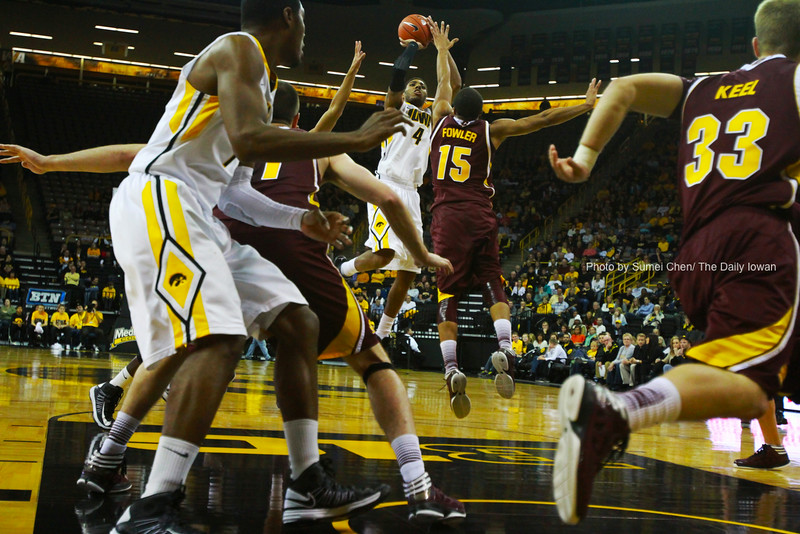Iowa guard Devyn Marble attempts to shoot against Central Michigan guard Chris Fowler at Carver-Hawkeye Arena in Iowa City, Iowa on Monday, November 12, 2012. Iowa defeated Central Michigan, 73-61. (The Daily Iowan/Sumei Chen)