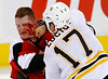 Ottawa Senators' Chris Neil (24) takes a punch in the face from Boston Bruins' Milan Lucic during first period NHL preseason hockey action in Ottawa Friday September 25, 2009.<br /> <br /> THE CANADIANPRESS/Fred Chartrand
