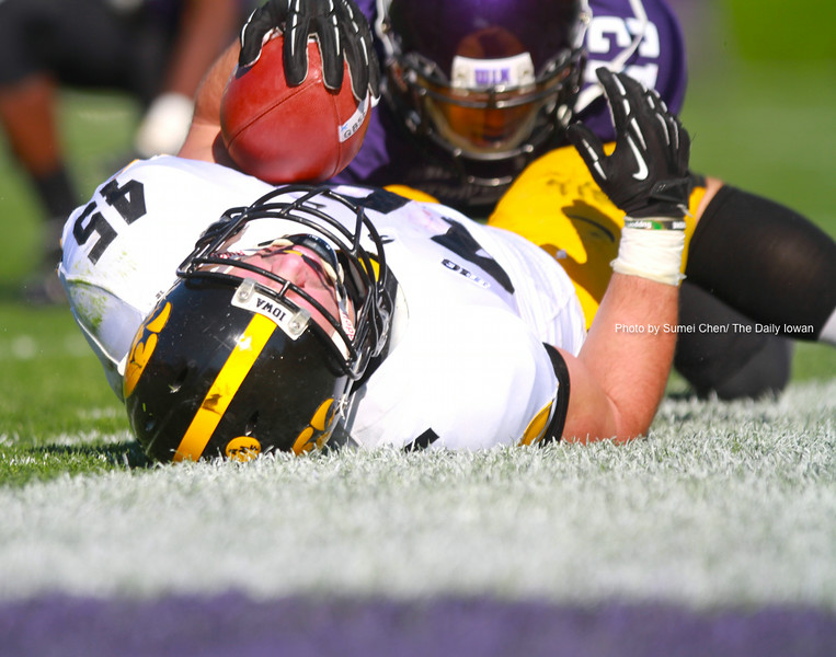Iowa running back Mark Weisman lays on the turf after being tackled during the game against Northwestern at Ryan Field, in Evanston, Illinois on Saturday, October 27, 2012. Northwestern Wildcats defeated Iowa Hawkeyes, 28-17. (The Daily Iowan/Sumei Chen)