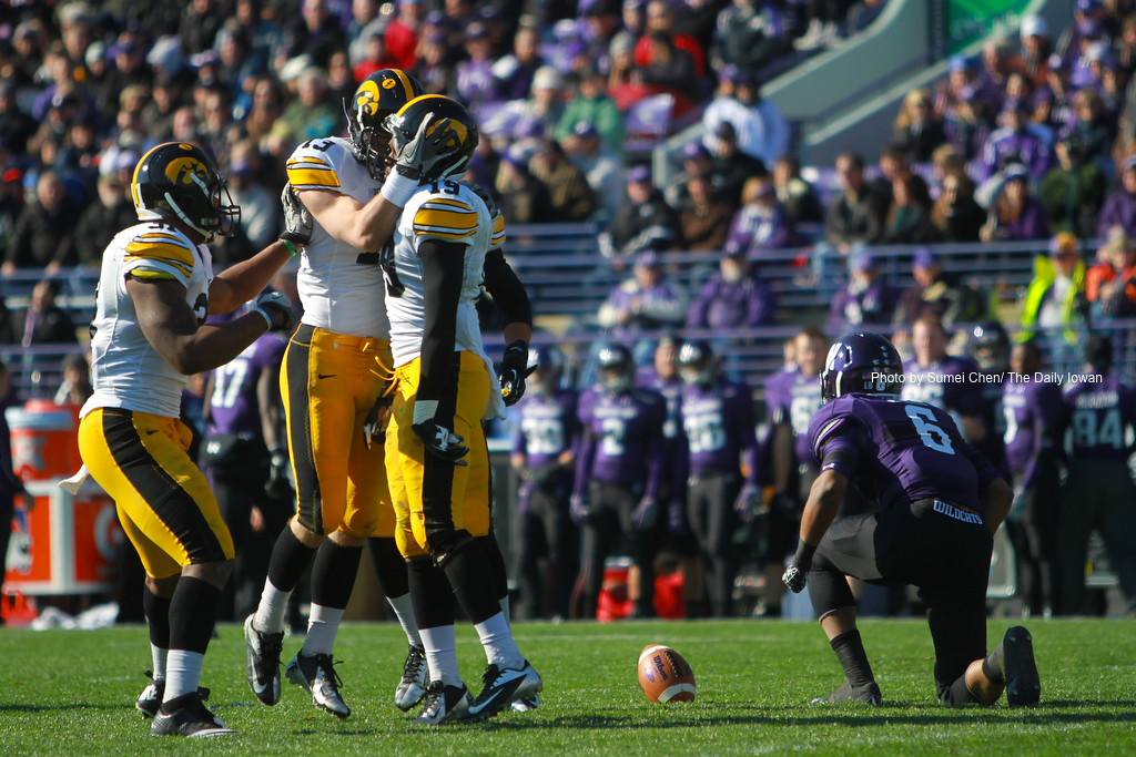 Iowa's Tom Donatell (13) celebrates with B.J. Lowery (19) during the game against Northwestern at Ryan Field, Evanston, Illinois on Saturday, October 27, 2012. Northwestern Wildcats defeated Iowa Hawkeyes, 28-17. (The Daily Iowan/Sumei Chen)
