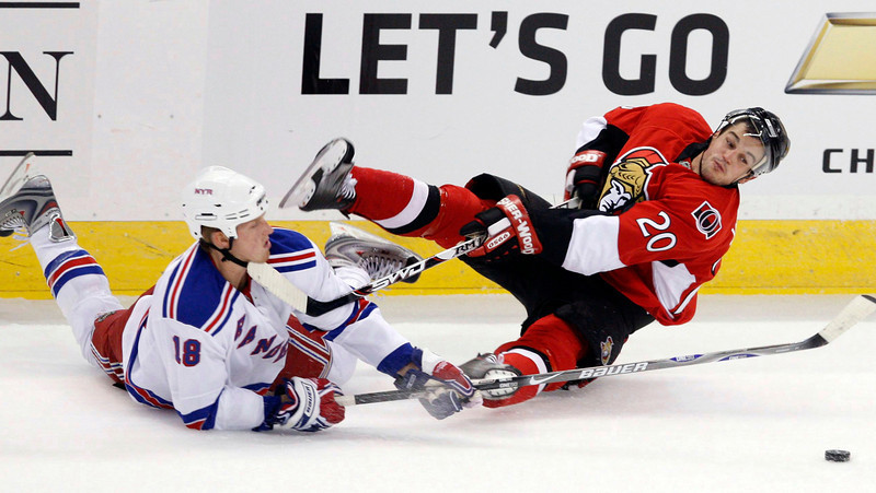 New York Rangers' Marc Stall (18) collides with Ottawa Senators' Antione Vermette (20) during first period NHL preseason hockey action in Ottawa on Saturday September 20, 2008.