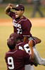 Texas Southern University pitcher Brandon Stricklen (33) leaps into the arms of his teammates Friday night at Reckling Park  after striking out a Rice University batter to win the game 4-3 during the NCAA regional tournament at Rice University in Houston. The game had been resumed after a two hour rain delay.<br /> PHOTO/SCOTT ESLINGER                     JUNE 4, 2004