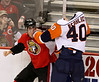 Ottawa Senators' Mike Fisher (12) and New York Islanders' Joel Rechlicz (40) fight during NHL second  period hockey in Ottawa, Saturday March 21, 2009. THE CANADIAN PRESS/Fred Chartrand