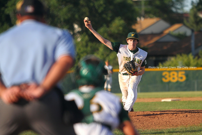 Iowa City, IA -  Luke Crimmins pitches for Iowa City West High against Cedar Rapids Washington. West High won the game 9-2. (The Daily Iowan/Sumei Chen)