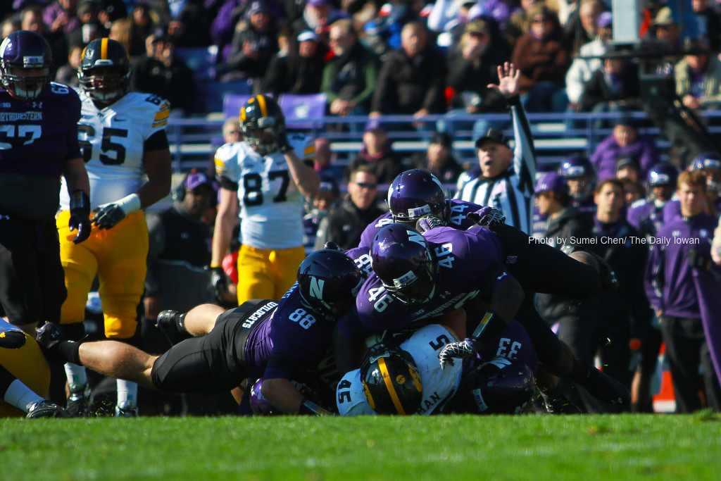 Iowa running back Mark Weisman is tackled by four Wildcat defenders during the game against Northwestern at Ryan Field, in Evanston, Illinois on Saturday, October 27, 2012. Northwestern Wildcats defeated Iowa Hawkeyes, 28-17. (The Daily Iowan/Sumei Chen)