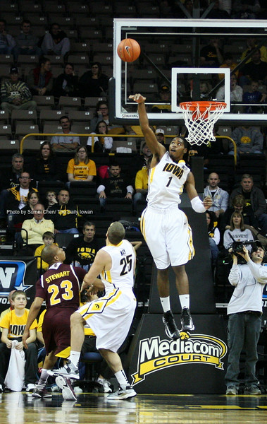 Iowa forward Melsahn Basabe blocks a shot by Central Michigan guard Austin Stewart at Carver-Hawkeye Arena in Iowa City, Iowa on Monday, November 12, 2012. Iowa defeated Central Michigan, 73-61. (The Daily Iowan/Sumei Chen)