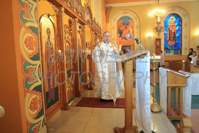 Fr. Daniel Gurovich emerges from behind the icon screen with the incensor during mass at St. Josaphat Ukrainian Catholic Church in Bethlehem, PA. photo/Don Blake Photography