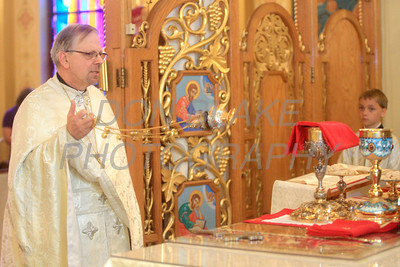 Fr. Daniel Gurovich uses the incensor to bless the host during mass at St. Josaphat Ukrainian Catholic Church in Bethlehem, PA. photo/Don Blake Photography